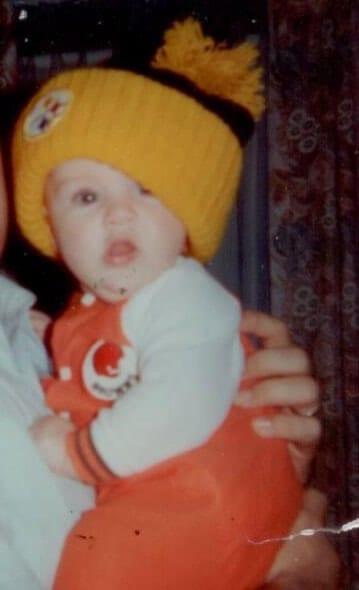 Baby Jamie Marich in a Steelers beanie cap.